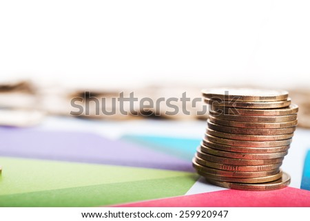 Diagram and coins on background - stock photo