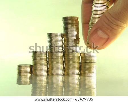 diagram consisting of piles of coins, denotes the artificial creation of the financial crisis - stock photo