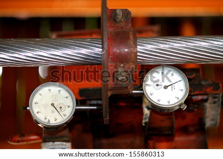 Dial gauge for tension test electrical cable - stock photo