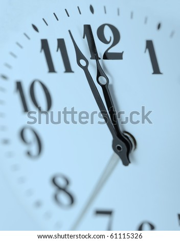Dial of analog hours. A photo close up. Blue tone. - stock photo