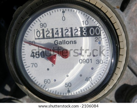 Dial on a water meter - stock photo