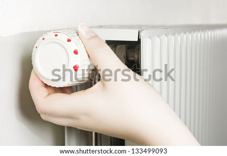 Dial with hearts on radiator - stock photo