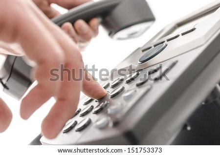 Dialing a phone number closeup with shallow depth of field. - stock photo