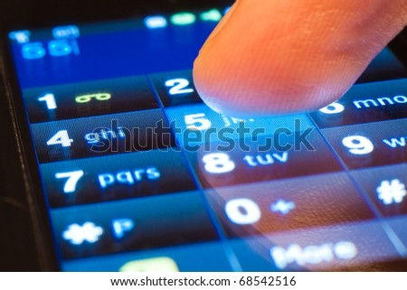 dialing on touchscreen smartphone - stock photo