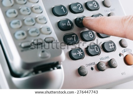 Dialing telephone numbers - stock photo