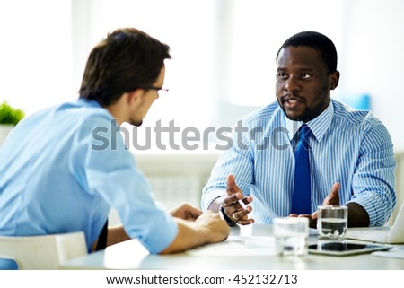 Dialogue of businessmen - stock photo