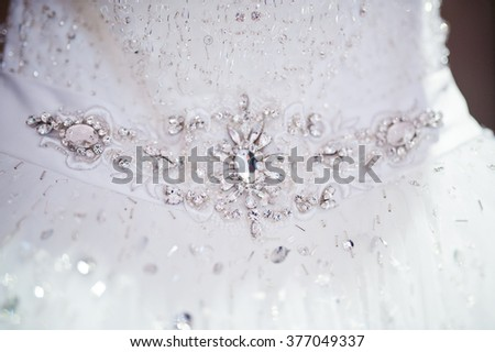 Diamond brooch at luxury wedding dress - stock photo