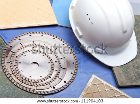 Diamond discs for cutting of tile and a helmet - stock photo