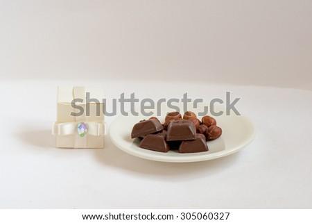 Diamond gift box and chocolate sweets - stock photo
