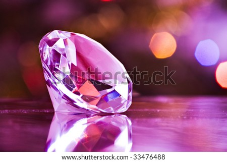 diamond in purple light with clipping path - stock photo