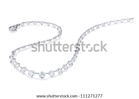 Diamond  necklace on a white background with reflection - stock photo