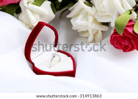 Diamond ring in beautiful heart box - stock photo