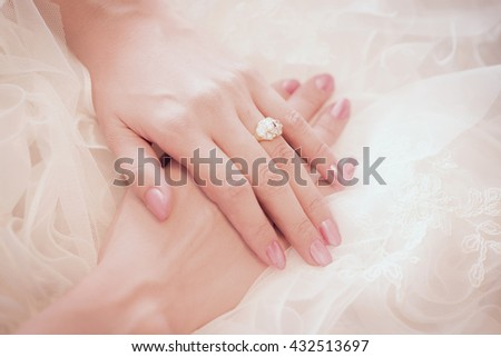 Diamond ring on a finger - stock photo