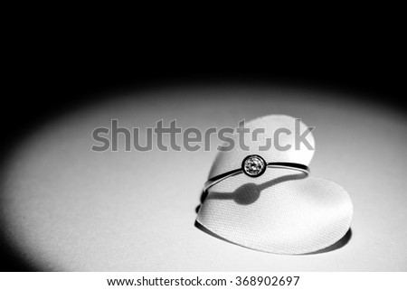 Diamond ring on heart (withe and black). - stock photo