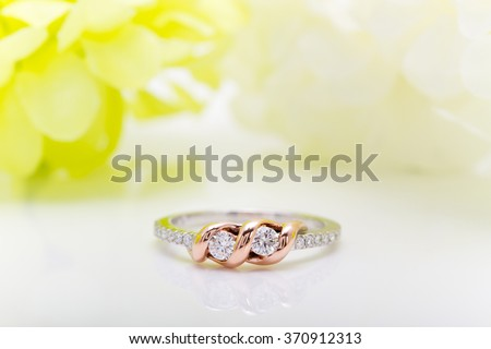 Diamond white gold ring with Flower background - stock photo
