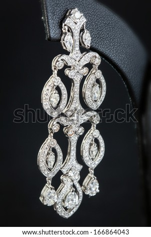 Diamonds Earring in black background - stock photo