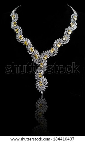 diamonds necklace shot against  a black background  - stock photo