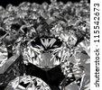 diamonds on black surface - stock photo