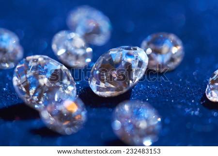 diamonds on blue background - stock photo
