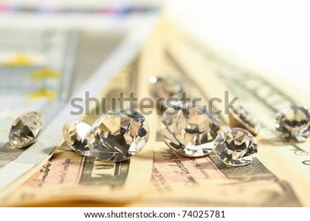 diamonds on the money - stock photo