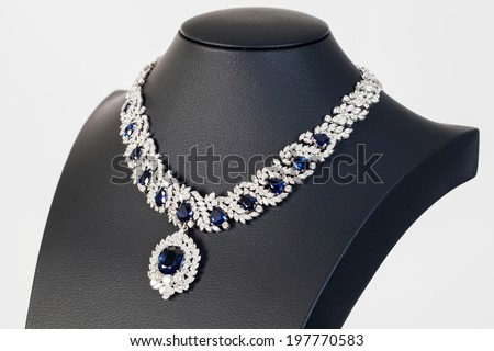 diamonds with dark blue sapphire necklace on the white background - stock photo