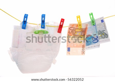 diaper and euro banknotes hanging on clothesline as concept of baby costs - stock photo