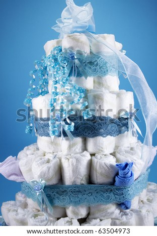 Diaper Cake A multi leveled diaper cake for a baby shower. Vertical. - stock photo