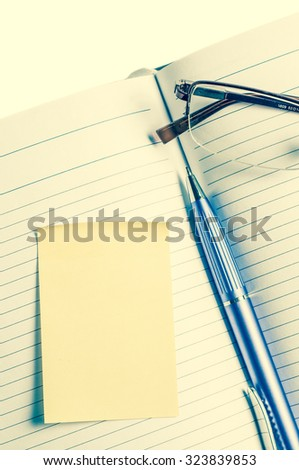 Diary and glasses. Processing in vintage style. - stock photo