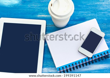 diary, mobile phone, tablet PC and coffe on the table - stock photo
