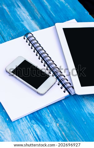 diary, mobile phone, tablet PC and glass of coffee on the table - stock photo