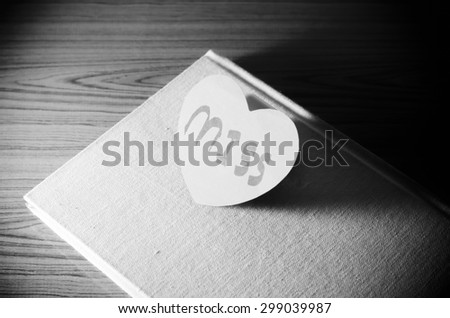 diary of love with notebook and heart on wood background black and white color tone style - stock photo