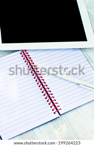 diary, pen and  tablet PC on the table - stock photo
