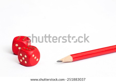 Dice and red pencil  - stock photo