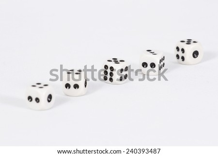 Dice are lined up diagonally/ Dice on white background - stock photo