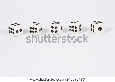 Dice are lined up in one row/ Dice on white background - stock photo