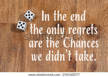 Dice on wood background with inspirational quote - stock photo