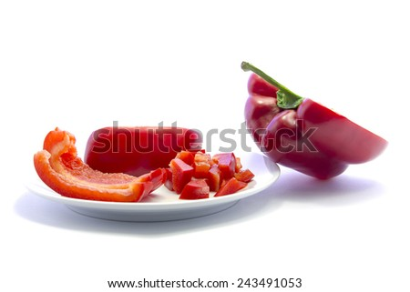 Dice red bell chili cutting and sliced ingredient on white plate and white background - stock photo