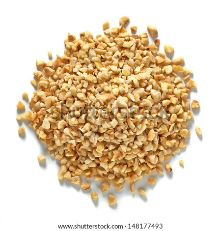 Diced hazelnuts pile from top on white background - stock photo