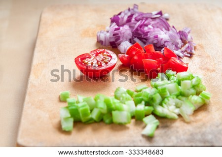 diced red onion, cherry tomatoes and green celery - stock photo