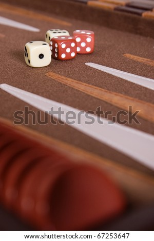 Dices and chips set to play backgammon - stock photo