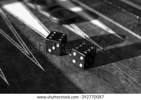 Dices on backgammon board - stock photo