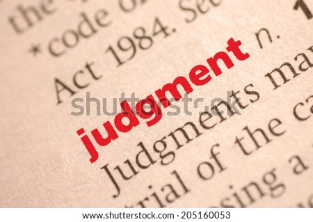 Dictionary definition of judgment. Close-up view, with paper textures, sepia tone - stock photo