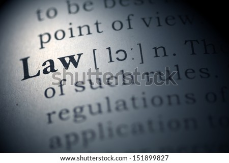 Dictionary definition of the word law.  - stock photo