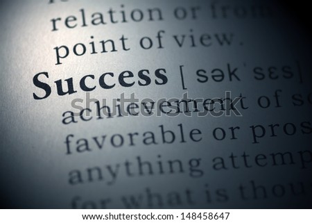 Dictionary definition of the word success.  - stock photo
