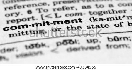 Dictionary entry for commitment - stock photo