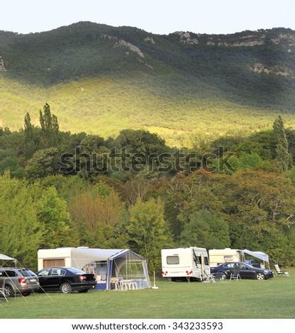 DIE, FRANCE-SEPTEMBER 16, 2015: Caravans at a remote camping in France.September 16, 2015 Die, France - stock photo