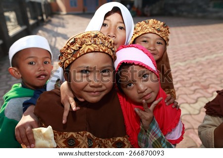 DIENG PLATEAU, JAVA, INDONESIA - September 21, 2012. : Unidentified family at home, This land height above sea level 2,000 meters Javanese ancient belief that the Plateau is the land of gods.  - stock photo