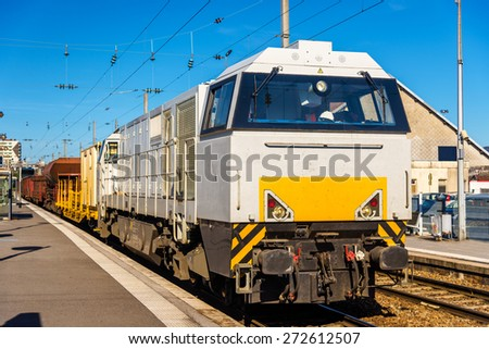 Diesel locomotive hauling a freight train at Besancon station - France - stock photo
