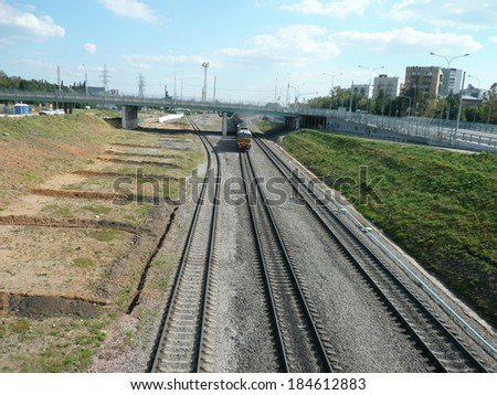 diesel locomotive on rails  moving at day - stock photo