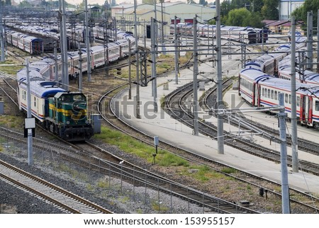 Diesel Locomotive pulling Carriages - stock photo